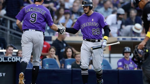 <p>               Colorado Rockies' DJ LeMahieu (9) is greeted by teammate Nolan Arenado after hitting a home run during the fourth inning of a baseball game against the San Diego Padres Saturday, Sept. 1, 2018, in San Diego. (AP Photo/Gregory Bull)             </p>