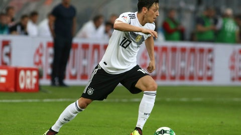 <p>               FILE - In this June 2, 2018 file photo Germany's Mesut Ozil runs with the ball during a friendly soccer match between Austria and Germany in Klagenfurt, Austria. (AP Photo/Ronald Zak, file)             </p>