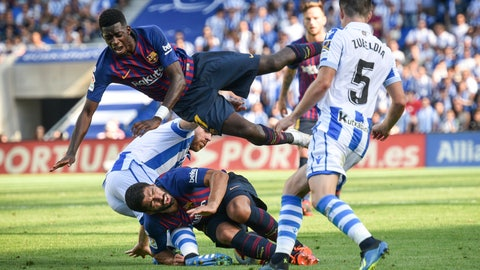<p>               FC Barcelona's Ousmane Dembele, top, and Luis Suarez, down, in action during the Spanish La Liga soccer match between Real Sociedad and FC Barcelona at the Anoeta stadium, in San Sebastian, northern Spain, Saturday, Sept. 15, 2018. (AP Photo/Jose Ignacio Unanue)             </p>