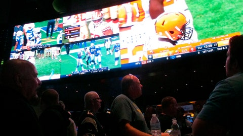 <p>               In this Sept. 9, 2018 photo, customers watch an NFL game in the sports betting lounge at the Ocean Resort Casino in Atlantic City, N.J. Figures released Sept. 12 by state gambling regulators show that New Jersey gamblers plunked down more than $95 million on sporting events, more than twice as much as a month earlier. (AP Photo/Wayne Parry)             </p>