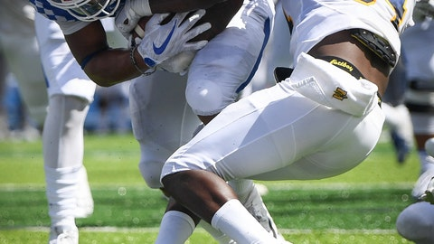 <p>               Kentucky running back Benny Snell Jr. scores a touchdown as he is tackled by Murray State defensive back Marquez Sanford (34) during the first half an NCAA college football game in Lexington, Ky., Saturday, Sept. 15, 2018. (AP Photo/Bryan Woolston)             </p>