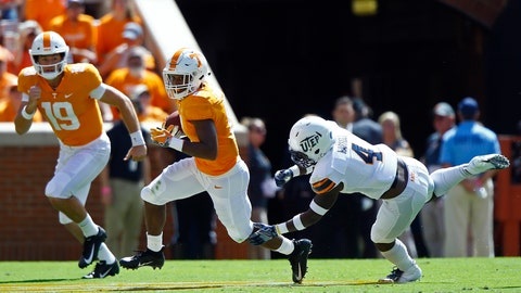 <p>               Tennessee running back Ty Chandler (8) runs away from UTEP defensive back Broderick Harrell (4) as quarterback Keller Chryst (19) trails during the first half of an NCAA college football game Saturday, Sept. 15, 2018, in Knoxville, Tenn. (AP Photo/Wade Payne)             </p>