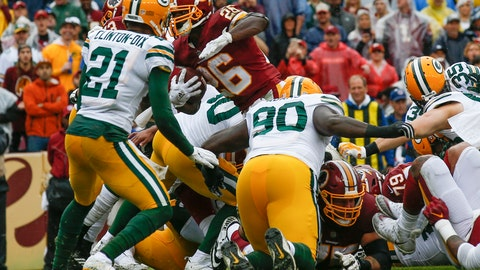 <p>               Washington Redskins running back Adrian Peterson (26) carries the ball into the end zone for a touchdown during the first half of an NFL football game against the Green Bay Packers, Sunday, Sept. 23, 2018, in Landover, Md. (AP Photo/Alex Brandon)             </p>