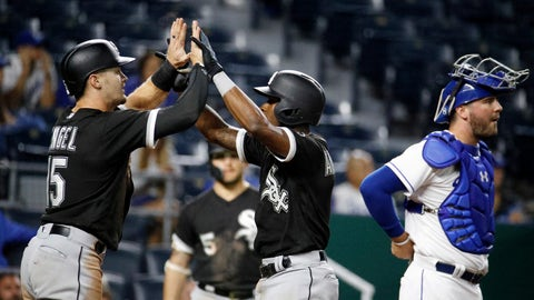 <p>               Chicago White Sox's Tim Anderson, center, celebrates with Adam Engel (15) as he crosses the plate past Kansas City Royals catcher Cam Gallagher after hitting a two-run home run during the 12th inning of a baseball game Wednesday, Sept. 12, 2018, in Kansas City, Mo. (AP Photo/Charlie Riedel)             </p>