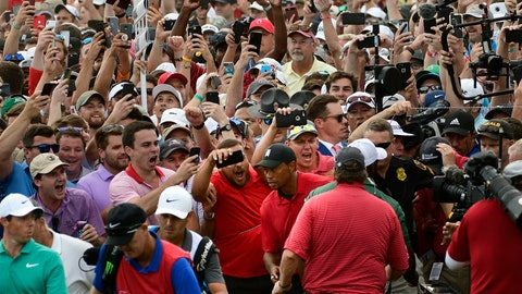 <p>               Tiger Woods, lower center, and Rory McIlroy, lower left, emerge from a horde of fans following Tiger on their way to the 18th green during the final round of the Tour Championship golf tournament Sunday, Sept. 23, 2018, in Atlanta. (AP Photo/John Amis)             </p>