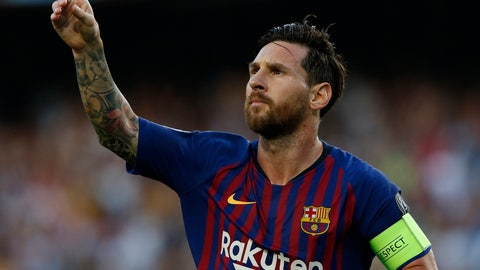 """<p>               FILE - In this Tuesday, Sept. 18, 2018 file photo, Barcelona's Lionel Messi celebrates after scoring the opening goal during their Champions League soccer match against PSV Eindhoven at the Camp Nou stadium in Barcelona, Spain. Barcelona says it plans to redesign the club's emblem for the start of next season. The most significant change would be the removal of the letters """"FCB"""" which have been at the center of the design for more than 100 years.  (AP Photo/Manu Fernandez, file)             </p>"""