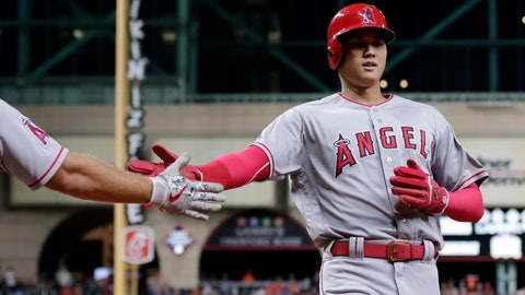 <p>               Los Angeles Angels designated hitter Shohei Ohtani (17) is congratulated as he scores the fourth run of the inning on the double by Andrelton Simmons during the sixth inning of a baseball game against the Houston Astros, Thursday, Aug. 30, 2018, in Houston. (AP Photo/Michael Wyke)             </p>