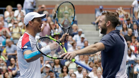 <p>               Mike Bryan, left, and Jack Sock celebrate after defeating Lukasz Kubot, of Poland, and Marcelo Melo, of Brazil, in the men's doubles final of the U.S. Open tennis tournament, Friday, Sept. 7, 2018, in New York. (AP Photo/Darron Cummings)             </p>
