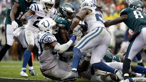 <p>               Philadelphia Eagles' Wendell Smallwood (28) scores a touchdown against Indianapolis Colts' Anthony Walker (50) and Clayton Geathers (26) during the second half of an NFL football game, Sunday, Sept. 23, 2018, in Philadelphia. (AP Photo/Matt Rourke)             </p>