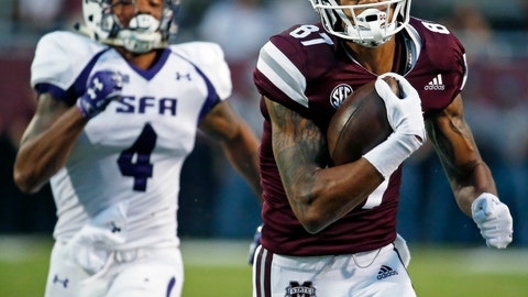 <p>               Mississippi State wide receiver Osirus Mitchell (87) runs past Stephen F. Austin safety Chris James (4) for a 84-yard touchdown pass reception during the first half of their NCAA college football game, Saturday, Sept. 1, 2018, in Starkville, Miss. (AP Photo/Rogelio V. Solis)             </p>