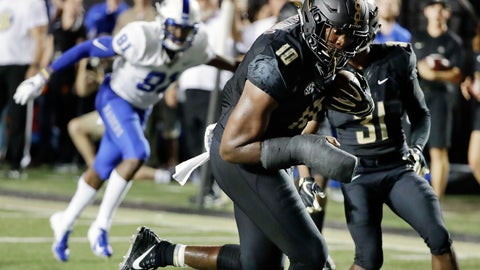 <p>               Vanderbilt defensive lineman Dayo Odeyingbo (10) runs the ball into the end zone for a touchdown after recovering a fumble by Middle Tennessee in the first half of an NCAA college football game Saturday, Sept. 1, 2018, in Nashville, Tenn. (AP Photo/Mark Humphrey)             </p>