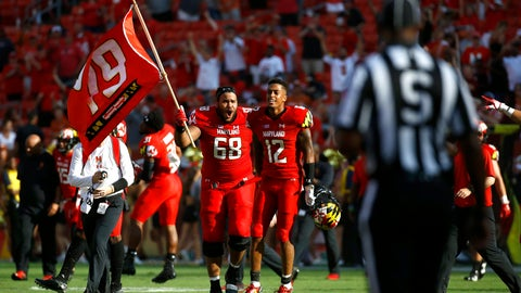 <p>               Maryland offensive lineman Ellis McKennie (68) walks with teammate Taivon Jacobs as he waves a flag in remembrance of offensive lineman Jordan McNair, who died after collapsing on a practice field during a spring practice, after an NCAA college football game against Texas, Saturday, Sept. 1, 2018, in Landover, Md. Maryland won 34-29. (AP Photo/Patrick Semansky)             </p>