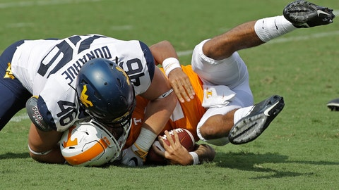<p>               West Virginia's Reese Donahue (46) sacks Tennessee's Jarrett Guarantano (2) in the first half of an NCAA college football game in Charlotte, N.C., Saturday, Sept. 1, 2018. (AP Photo/Chuck Burton)             </p>