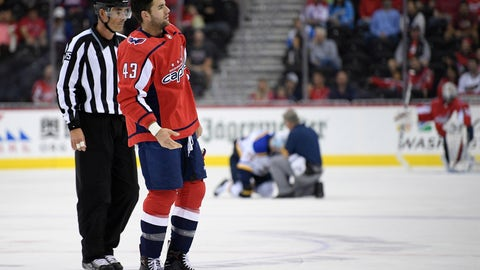 <p>               Washington Capitals right wing Tom Wilson (43) is escorted by an official off the ice after he checked St. Louis Blues center Oskar Sundqvist, on ice at back center, during the second period of an NHL preseason hockey game, Sunday, Sept. 30, 2018, in Washington. (AP Photo/Nick Wass)             </p>