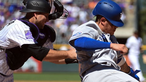 <p>               Los Angeles Dodgers' Manny Machado, right, slides into home plate, knocking the ball out of Colorado Rockies catcher Chris Iannetta's glove, to score in the first inning of a baseball game Sunday, Sept. 9, 2018, in Denver. (AP Photo/John Leyba)             </p>