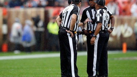 <p>               FILE - In this Sunday, Sept. 9, 2018, file photo, referee Shawn Smith, second from right, and members of his crew meet for a conference during an NFL football game between the Pittsburgh Steelers and the Cleveland Browns in Cleveland. NFL officials come from a pipeline established by the NleagueL that seeks to identify people with the right skill set, temperament and judgment to handle a thankless job week after week. (Jeff Haynes/AP Images for Panini, File)             </p>