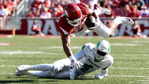 <p>               Arkansas tight end Jeremy Patton is tackled by North Texas defender Khairi Muhammad in the first half of an NCAA college football game Saturday, Sept. 15, 2018, in Fayetteville, Ark. (AP Photo/Michael Woods)             </p>