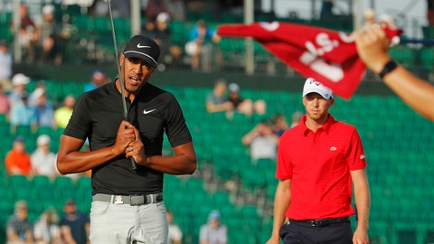 <p>               FILE - In this June 17, 2018, file photo, Tony Finau, left, reacts after a putt on the 16th green during the final round of the U.S. Open Golf Championship, in Southampton, N.Y. Finau has no problem with Nike's new campaign with Colin Kaepernick. (AP Photo/Carolyn Kaster, File)             </p>