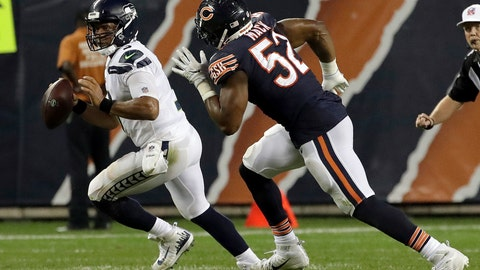 <p>               Chicago Bears linebacker Khalil Mack (52) chases Seattle Seahawks quarterback Russell Wilson (3) during the second half of an NFL football game Monday, Sept. 17, 2018, in Chicago. (AP Photo/Nam Y. Huh)             </p>