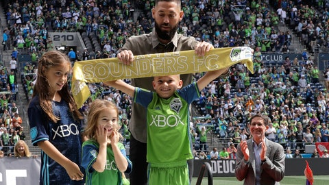 <p>               Seattle Sounders forward Clint Dempsey, top, helps his son Jackson hold up the golden scarf as his daughters Elyse, left, and Sophia, second from left, look on and Sounders owner Adrian Hanauer applauds at right, Saturday, Sept. 1, 2018, in Seattle, during a pre-match ceremony to honor Dempsey, who announced his retirement from professional soccer earlier in the week. (AP Photo/Ted S. Warren)             </p>