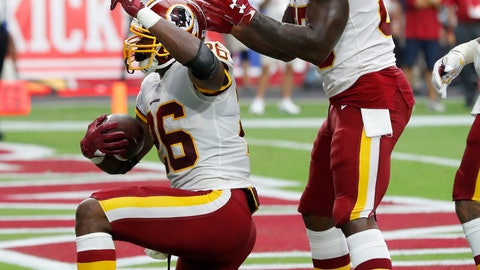 <p>               Washington Redskins running back Adrian Peterson (26) celebrates his touchdown against the Arizona Cardinals with tight end Vernon Davis (85) during the first half of an NFL football game, Sunday, Sept. 9, 2018, in Glendale, Ariz. (AP Photo/Rick Scuteri)             </p>