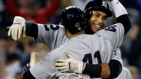 <p>               Detroit Tigers' Victor Reyes celebrates with teammate Victor Martinez after scoring on a wild pitch during the ninth inning to defeat the St. Louis Cardinals 4-3 in a baseball game, Saturday, Sept. 8, 2018, in Detroit. The Tigers and Cardinals are wearing uniforms from 1968. (AP Photo/Duane Burleson)             </p>