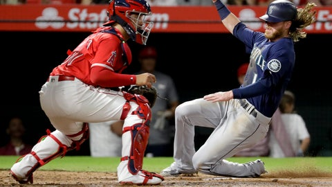 <p>               Seattle Mariners' Ben Gamel scores past Los Angeles Angels third baseman Jefry Marte on a sacrifice fly by Dee Gordon during the second inning of a baseball game in Anaheim, Calif., Thursday, Sept. 13, 2018. (AP Photo/Chris Carlson)             </p>