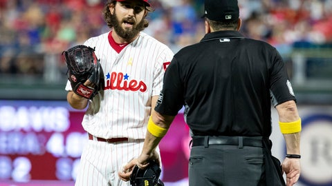 <p>               Philadelphia Phillies relief pitcher Austin Davis, left, talks with umpire Marty Foster, right, during the eighth inning of a baseball game against the Chicago Cubs, Saturday, Sept. 1, 2018, in Philadelphia. Umpire Joe West confiscated a card from Davis in the eighth inning of Philadelphia's 7-1 loss. Davis and Phillies manager Gabe Kapler said he was using the card merely for information on the Cubs hitters. But West said it was illegal under Rule 6.02(c)(7), which states that the pitcher shall not have on his person, or in his possession, any foreign substance. (AP Photo/Chris Szagola)             </p>