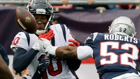 <p>               New England Patriots linebacker Elandon Roberts (52) breaks up a pass intended for Houston Texans wide receiver DeAndre Hopkins (10) during the first half of an NFL football game, Sunday, Sept. 9, 2018, in Foxborough, Mass. (AP Photo/Charles Krupa)             </p>
