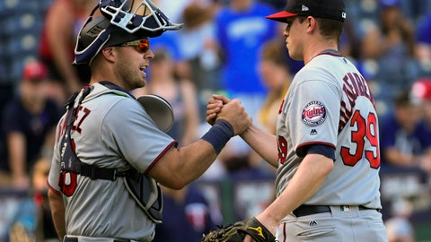 <p>               Minnesota Twins catcher Chris Gimenez congratulates teammate relief pitcher Trevor Hildenberger (39) following their win over the Kansas City Royals during a baseball game in Kansas City, Mo., Sunday, Sept. 16, 2018. (AP Photo/Reed Hoffmann)             </p>