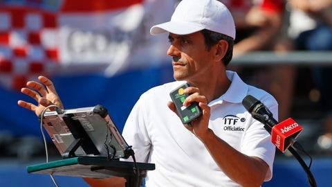 <p>               Tennis umpire Carlos Ramos, left, prepares to officiate the Davis Cup semifinal singles match between Sam Querrey of the United States and  Marin Cilic of Croatia, in Zadar, Croatia, Sunday, Sept. 16, 2018. (AP Photo/Darko Bandic)             </p>