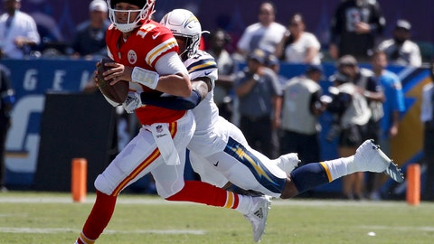<p>               Los Angeles Chargers defensive back Derwin James, right, tackles Kansas City Chiefs quarterback Patrick Mahomes during the first half of an NFL football game Sunday, Sept. 9, 2018, in Carson, Calif. (AP Photo/Kelvin Kuo)             </p>