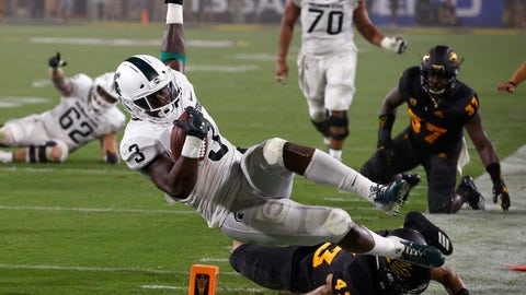 <p>               Michigan State running back LJ Scott (3) gets tackled by Arizona State safety Jalen Harvey (43) during the first half of an NCAA college football game Saturday, Sept. 8, 2018, in Tempe, Ariz. (AP Photo/Ross D. Franklin)             </p>