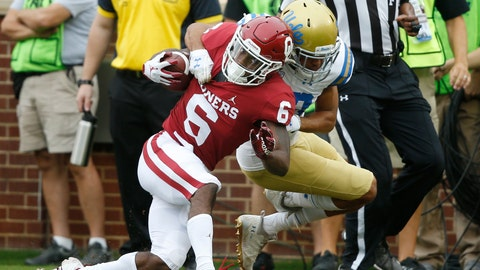 <p>               Oklahoma cornerback Tre Brown (6) is brought down by UCLA defensive back Nate Meadors (22) after an 86 yard kick off return in the first quarter of an NCAA college football game in Norman, Okla., Saturday, Sept. 8, 2018. (AP Photo/Sue Ogrocki)             </p>