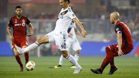 <p>               Los Angeles Galaxy forward Zlatan Ibrahimovic (9) controls the ball against Toronto FC midfielder Michael Bradley (4) during the first half of an MLS soccer game, Saturday, Sept. 15, 2018 in Toronto. (Cole Burston/Canadian Press via AP)             </p>