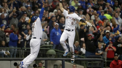 <p>               Milwaukee Brewers' Ryan Braun is congratulated by third base coach Ed Sedar after hitting a home run during the first inning of a baseball game against the Detroit Tigers Friday, Sept. 28, 2018, in Milwaukee. (AP Photo/Morry Gash)             </p>