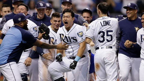 <p>               Tampa Bay Rays' Ji-Man Choi, of South Korea, center, celebrates his two-run walk-off home run off Cleveland Indians pitcher Brad Hand during the ninth inning of a baseball game Monday, Sept. 10, 2018, in St. Petersburg, Fla. (AP Photo/Chris O'Meara)             </p>