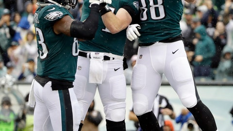 <p>               Philadelphia Eagles' Dallas Goedert, from right, Carson Wentz and Josh Perkins celebrate after Goedert's touchdown during the first half of an NFL football game against the Indianapolis Colts, Sunday, Sept. 23, 2018, in Philadelphia. (AP Photo/Matt Rourke)             </p>