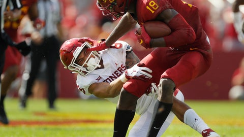 <p>               Iowa State wide receiver Hakeem Butler, right, fends off Oklahoma safety Kahlil Haughton, left, to run for a first down during the first half of an NCAA college football game, Saturday, Sept. 15, 2018, in Ames, Iowa. (AP Photo/Matthew Putney)             </p>
