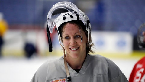 <p>               FILE - In this Dec. 15, 2016, file photo,  United States forward Meghan Duggan smiles after hockey practice in Plymouth Township, Mich. Former Canadian women's hockey team forward Gillian Apps and American forward Meghan Duggan married this past weekend in Pownal, Maine. (AP Photo/Carlos Osorio, File)             </p>