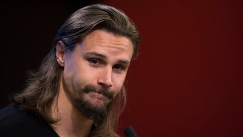 <p>               Erik Karlsson, who as traded by the Ottawa Senators to the San Jose Sharks, speaks to media as the Senators reported for the first day of NHL hockey training camp in Ottawa, Thursday, Sept. 13, 2018. (Sean Kilpatrick/The Canadian Press via AP)             </p>