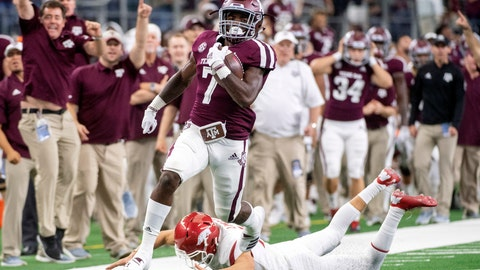 <p>               Texas A&M kick returner Jashaun Corbin (7) avoids the diving tackle of Arkansas kicker Connor Limpert as he returns the opening kickoff for a touchdown during the first quarter of an NCAA college football game Saturday, Sept. 29, 2018, in Arlington, Texas. (AP Photo/Jeffrey McWhorter)             </p>