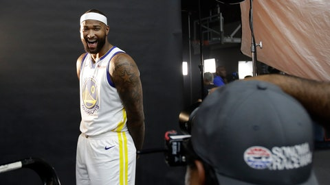 <p>               Golden State Warriors' DeMarcus Cousins, left, smiles while posing for photos for a news photographer during media day at the NBA basketball team's practice facility in Oakland, Calif., Monday, Sept. 24, 2018. (AP Photo/Jeff Chiu)             </p>