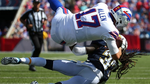 <p>               Buffalo Bills quarterback Josh Allen, top, is tacked by Los Angeles Chargers' Jahleel Addae during the second half of an NFL football game, Sunday, Sept. 16, 2018, in Orchard Park, N.Y. (AP Photo/Rich Barnes)             </p>