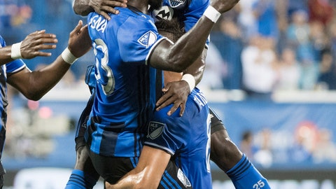 <p>               Montreal Impact's Bacary Sagna, left, celebrates with teammates Micheal Azira and Saphir Taider (8) after scoring against the New York Red Bulls during the first half of an MLS soccer match Saturday, Sept. 1, 2018, in Montreal. (Graham Hughes/The Canadian Press via AP)             </p>