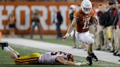 <p>               Texas quarterback Sam Ehlinger (11) works to stay in bounds as he runs past Southern California linebacker Porter Gustin (45) during the first half of an NCAA college football game, Saturday, Sept. 15, 2018, in Austin, Texas. (AP Photo/Eric Gay)             </p>