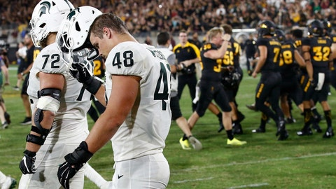 <p>               FILE - In this Saturday, Sept. 8, 2018, file photo, Arizona State players celebrate a game-winning field goal as Michigan State's Kenny Willekes (48) and Mike Panasiuk (72) walk off the field at the end after an NCAA college football game, in Tempe, Ariz. Arizona State defeated Michigan State 16-13. The last two Big Ten champions didn't make college football's playoff, in part because of early losses against tough non-conference foes. This year, Michigan State and Michigan have already dropped games, reducing their margins for error and raising again the question of whether playing tough teams out of conference is worth the risk (AP Photo/Ross D. Franklin, File)             </p>