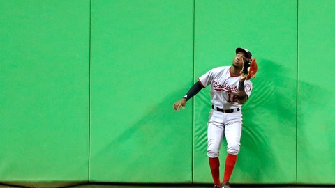 <p>               Washington Nationals center fielder Victor Robles catches a ball at the wall hit by Miami Marlins' Starlin Castro during the sixth inning of a baseball game, Monday, Sept. 17, 2018, in Miami. (AP Photo/Wilfredo Lee)             </p>