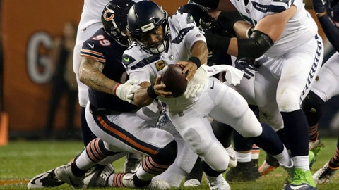 <p>               Chicago Bears linebacker Aaron Lynch (99) sacks Seattle Seahawks quarterback Russell Wilson (3) during the first half of an NFL football game Monday, Sept. 17, 2018, in Chicago. (AP Photo/David Banks)             </p>