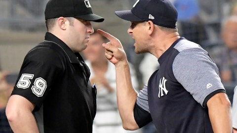 <p>               New York Yankees manager Aaron Boone, right, confronts umpire Nic Lentz (59) before being tossed from a baseball game against the Detroit Tigers during the fifth inning Friday, Aug. 31, 2018, at Yankee Stadium in New York. (AP Photo/Bill Kostroun)             </p>